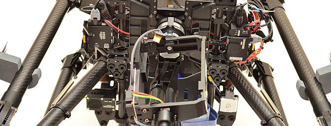 A broad overview of the underside of the S1000. You can see the four mounting brackets that contain the gimbal GCU, IOSD mark II, AVL58 VTX, and LED status indicator.
