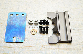 The parts to assemble the latch.
