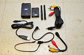 The video transmitter, receiver, and included accessories.