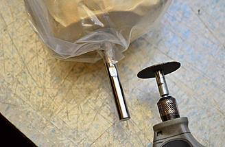 Using a dremel cutting wheel to grind a flat spot.