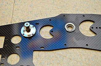 An upper side frame with a bellcrank pivot installed.