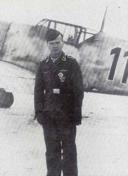 Peter Bremer of Jagdgeschwader 1/.54. This shot was apparently taken a few months before the unit was equipped with the Fw190. His previous mount, a BF109 is in the background
