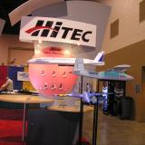 Hitec displayed all its new smaller products on a single board, directly behind the Multiplex electric aircraft lineup.