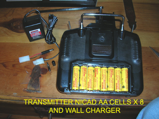 I flew the first flights with dry cells in the transmitter, but later changed to rechargeable NiCads that can be purchased complete with a simple wall charger from many sources. This will save money over time.