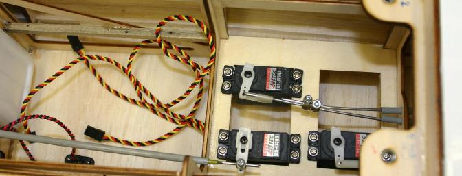 My single servo was connected to the two elevator push rods by connecting the two together with a pair of wheel collars.  I preferred to use the collars to get the elevator halves centered to begin with, and then wrap some copper wire around the joint and