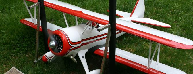 Rather than remove the engine from the plane and mount it on a stand, I bolted the wings to the Stearman and took it to my �engine testing area� in the back yard.