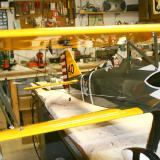 One end is permanently attached to the fuselage. The other end loops around the strut and attaches back at the fuselage, making a double rigging for each.