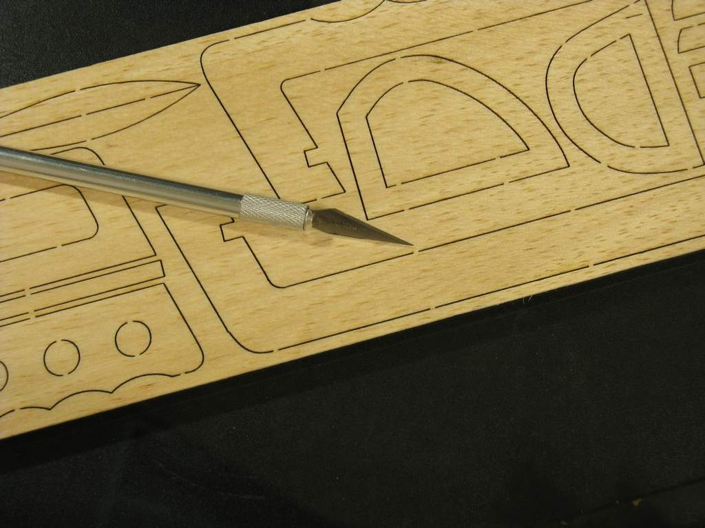 Carefully cut tabs holding parts in balsa sheet