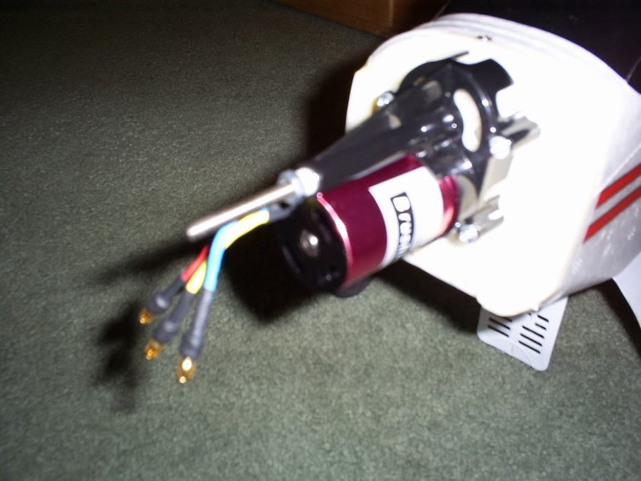 Close-up view of the motor and gearbox mounted on plane.