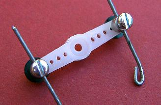 Micro connectors and pushrod wire with eyelets.