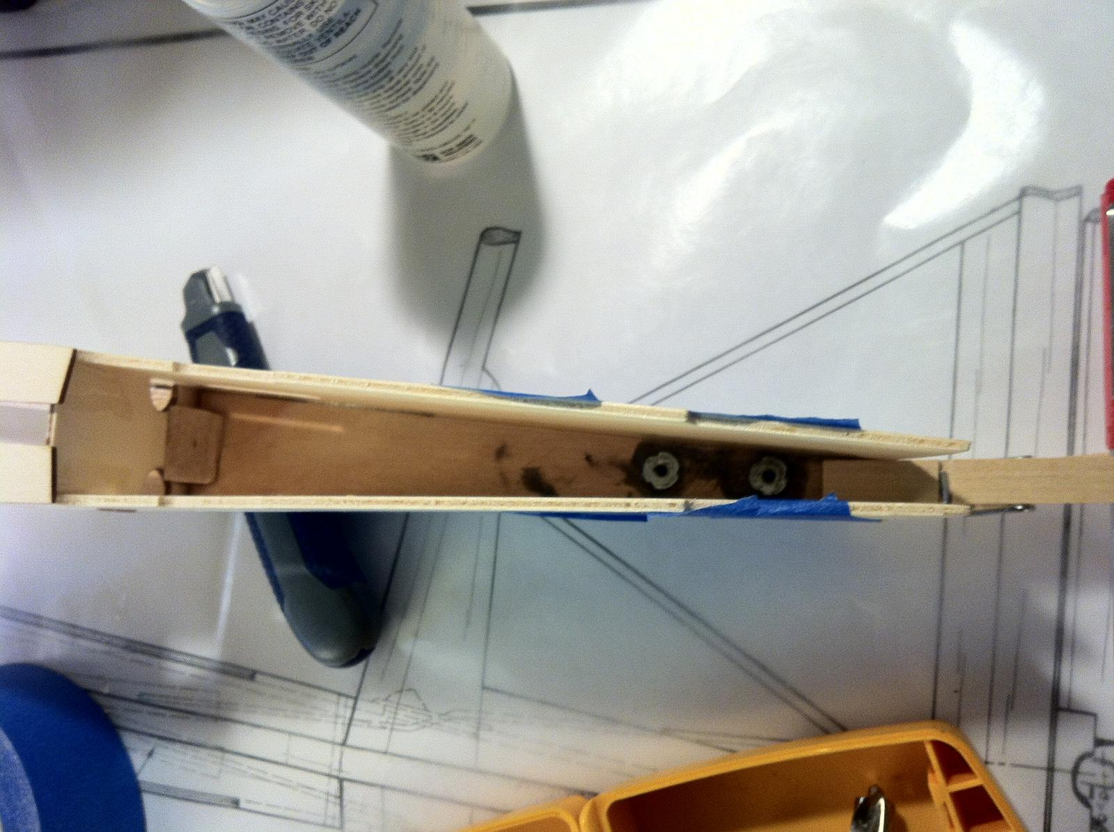 Tail wheel re-enforcement epoxyed into place.
