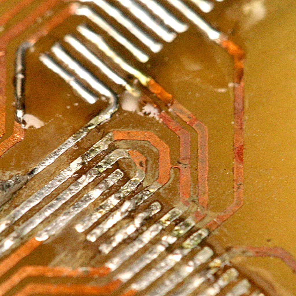 A bridged trace under a chip can ruin several of your days.