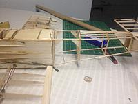 Name: image-f2f5de7a.jpg Views: 29 Size: 640.7 KB Description: I fixed the connection to the front fuselage and reinforced it with plywood braces.
