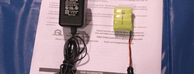 A closer view of the supplied charger and the 7 cell 300 mAh NiMH battery pack.