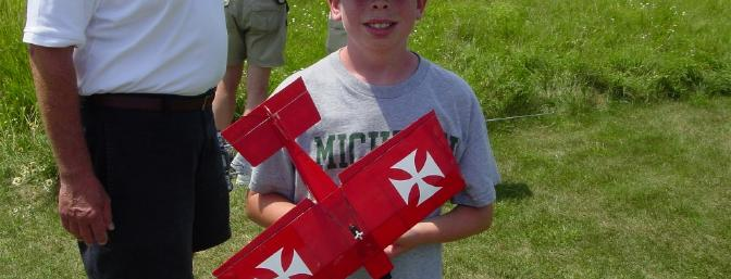 Twelve-year-old Chris Hass was the youngest pilot attending, shown here with his dad's Radical R/C Micro Stik.  This laser-cut balsa kit was powered with a GWS IPS direct driver system and 2Sx500mAh Lipos.