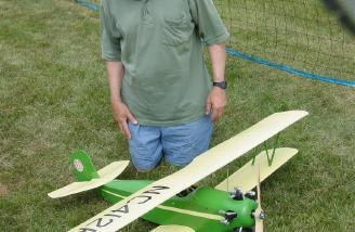 Tom and his Concept Models Fleet Biplane. Aveox 1412/2Y and now LiPo powered, it flies better than ever.