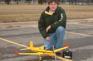 The author posed with the flight-ready airplane.