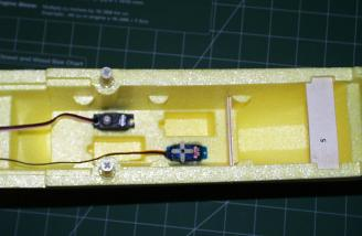 I chose to use my lone HS-55 in the fuselage so that I would have a matched pair of servos for the ailerons.