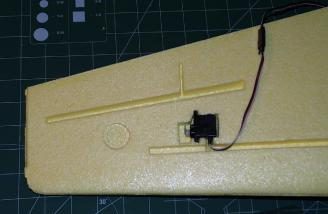 The GWS �Naro� servos have a different profile from the Graupner servos the plane was designed around, so a little foam removal was necessary to mount the aileron servos.