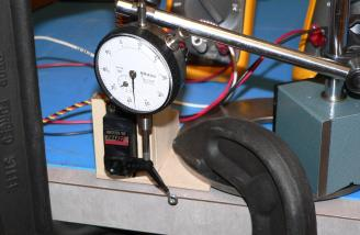 Here you can see the frame made to hold the servo in place.  The dial indicator is pushed by the servo arm.