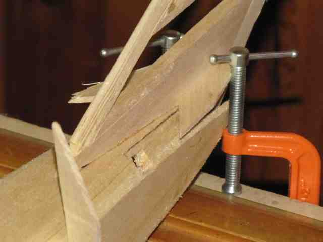 using clamps to  both hold fuse during setup and use as wedge points for vertical fin