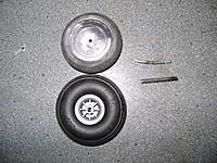 Name: DSC00527.jpg Views: 309 Size: 136.1 KB Description: Eje de acero y rueda �seria�du-bro,  en contraste con el eje de hierro dulce y la rueda de pl�stico y gomaespuma.