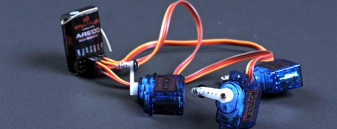 Before you glue the servos, make sure they are centered; otherwise it might be hard to do so afterward. I also installed some Du-Bro pushrod connectors on mine, which makes centering even easier without sacrificing much on weight.