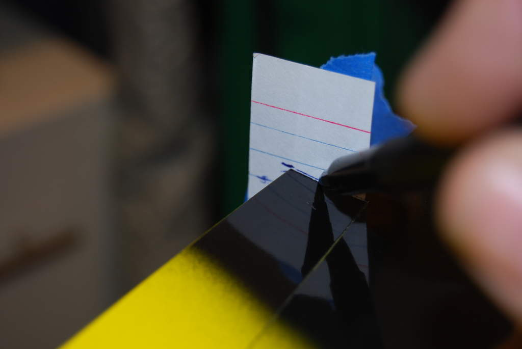 Tape the card in the tip and center the neutral on a line. Then make traces at different positions