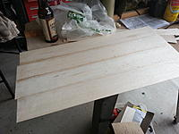 Name: 20130720_135715-1478811470.jpg Views: 293 Size: 183.3 KB Description: gluded together my 1/16 balsa strips and made sheet then sanded it smooth.