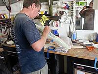 Name: 20130720_1727141505683727.jpg Views: 321 Size: 228.8 KB Description: Brian glassing a hatch.