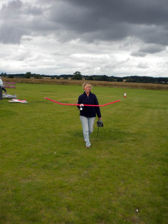 "Netty with her ""adequately powered"" Early Bird glider, which has been transformed into a warmliner by brushless and lipo having enticed Tim back to the hobby several years ago on brushed nicd power system."