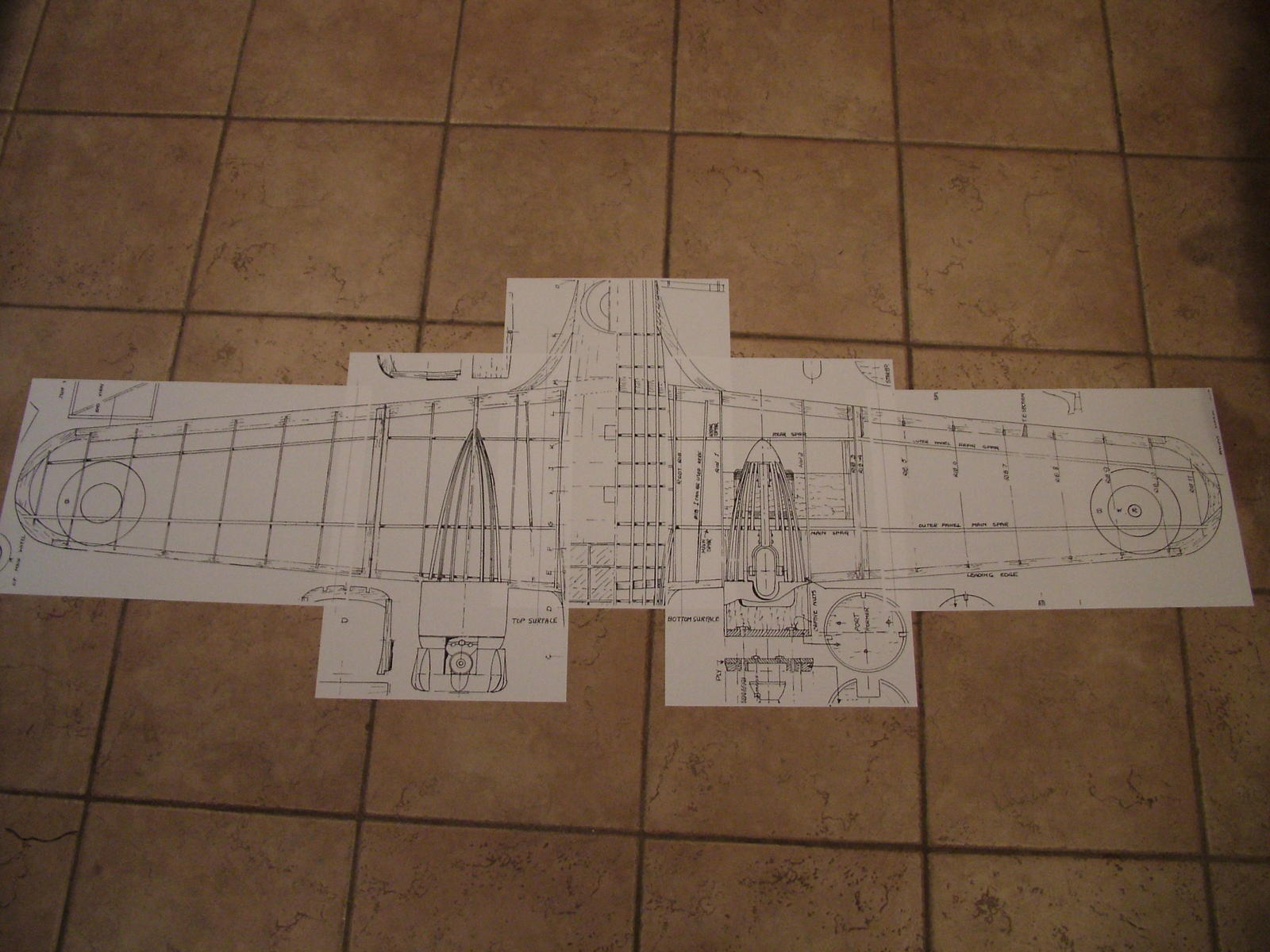 11x17 sheets roughly layed out on floor.  12x12 tiles for reference