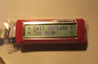 A similar warning is provided for a high-voltage condition