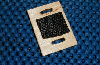 A small ply piece allows use of a Velcro strap