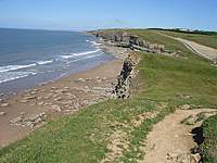 Name: Dunraven (15).jpg Views: 48 Size: 99.3 KB Description: View for on top of one of the cliffs looking down in to the bay, the tide was coming in.