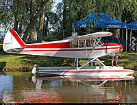 Name: redandwhite supercub on floats.jpg