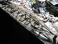 Name: m_004.jpg Views: 16 Size: 82.0 KB Description: More stringers added, & some carbon rod added to strengthen the keel area.