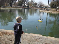 Name: Aden watching Rons boat.jpg
