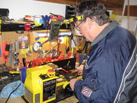 Name: Bill trying his hand at Lathe.jpg