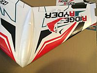 Name: 20150128_010945163_iOS.jpg Views: 66 Size: 554.2 KB Description: Skid plate glued on off center. Easily removed.