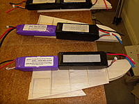 Name: SAM_0528.jpg Views: 297 Size: 236.9 KB Description: Elevator halves being skinned up in 1/16 sheet. Batteries make convenient weights!