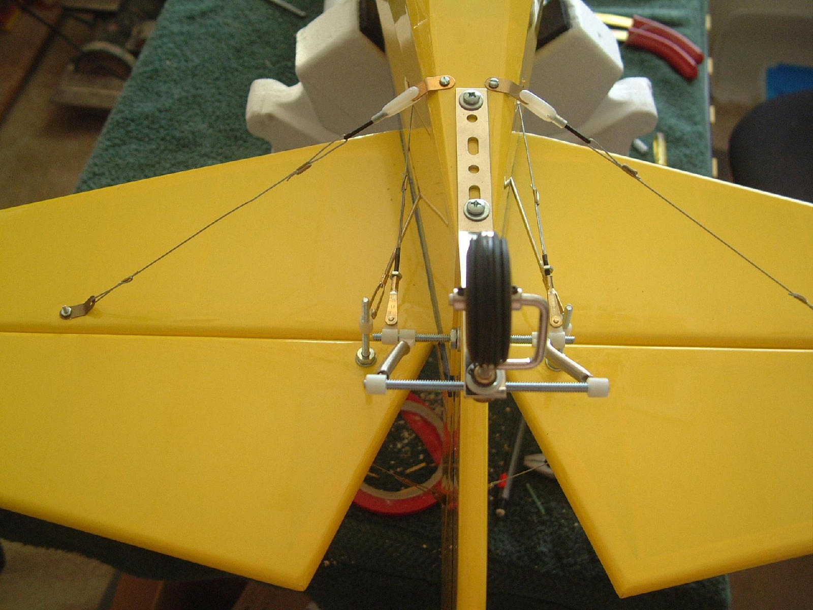 Note the NYLON clevis on bottom connection. I replaced the metal flying wire clevises with nylon to minimize the change of the flying wires acting as antennae!