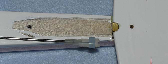 Some of the covering had to be removed from the fuselage to make a wood-to-wood joint for the fillets which adds tremendous strength to the vertical stabilizer. The covering was also removed from the vertical. And notice the epoxy in the hole on the right.