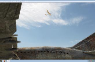 A favorite glider (Bird of Time) hunting for thermals over the desert aircraft junkyard.
