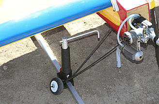 Don's front wheel didn't have a chance of moving backward with this arrangement. The front retaining devices will fall forward when the rear arms fall forward and the plane begins to move.