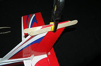 The rudder is 'locked' in neutral by two Popsicle sticks and one clamp.