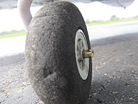 Name: IMG_2934.jpg Views: 4 Size: 359.7 KB Description: Brass bullet cut down and C A ed on axle as keeper