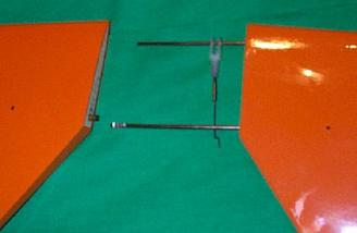 Components of the full-flying stabilizer.  The stabilizer rotates around the rear rod, while the servo moves the front rod.