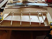 Name: P1090373.JPG Views: 19 Size: 105.3 KB Description: Glue the first balsa side to the ribs.