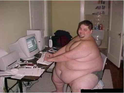 a4015937-18-really-fat-guy-on-computer.j